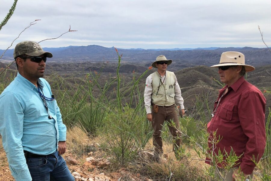 Geological team with Mercedes Mine in background
